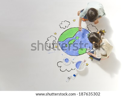 children drawing a picture of earth - stock photo