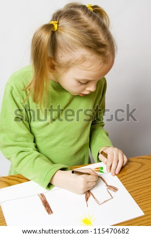 Children drawing with markers on the grey background