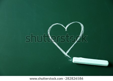 Children drawings on school blackboard background - stock photo