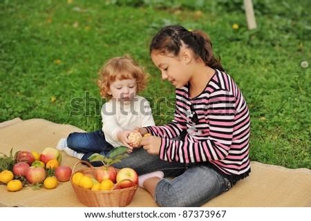 children eat a tangerine ... - stock photo