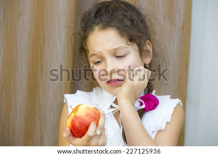 children eating juicy red apple - stock photo