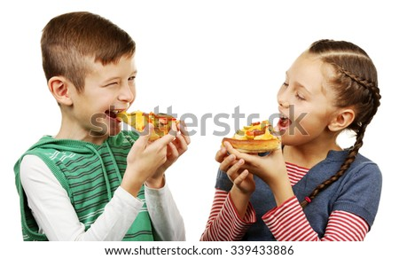 Children eating pizza isolated on white - stock photo