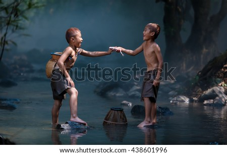 Children enjoyed the fishing. - stock photo