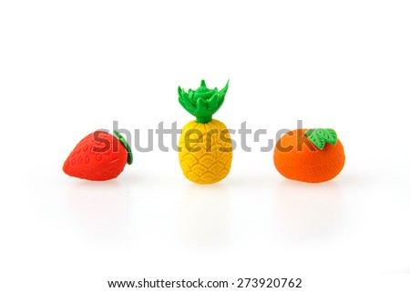 Children erasers shaped fruit on a white background. - stock photo