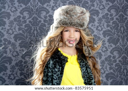 children fashion little girl with winter leopard coat and fur hat - stock photo