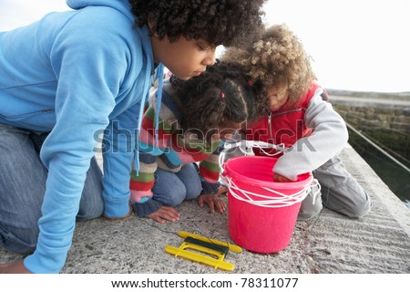 Children fishing for crabs