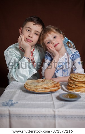 children for a holiday with pancakes  - stock photo