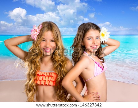 children friends girls happy together in tropical beach vacation - stock photo