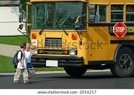 Children Getting off School Bus - stock photo