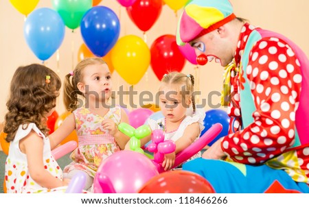children girls and clown on birthday party - stock photo