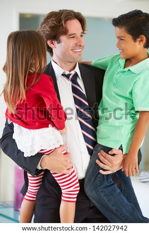 Children Greeting Father On Return From Work - stock photo