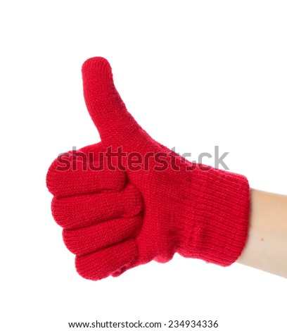 Children hand dressed in glove with thumb up isolated on white background  - stock photo