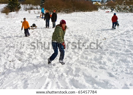 children have a snowball fight in the white beautiful snowy area - stock photo