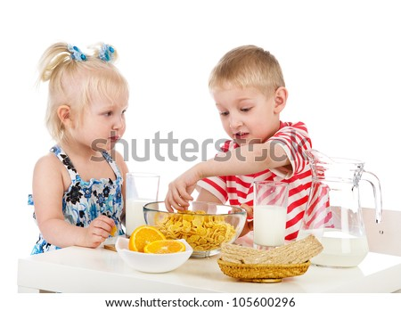 children have breakfast. isolated on white background - stock photo