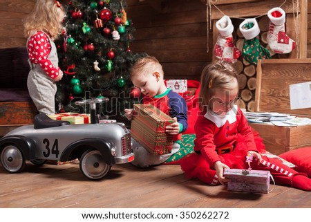 Children have fun on Christmas eve - stock photo