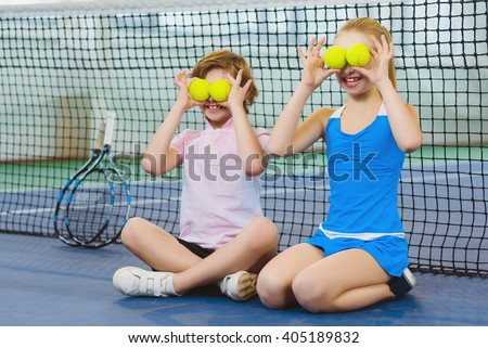 children having fun and playing on the tennis court - stock photo