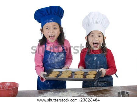 Children having fun cooking by themselves for the first time. - stock photo