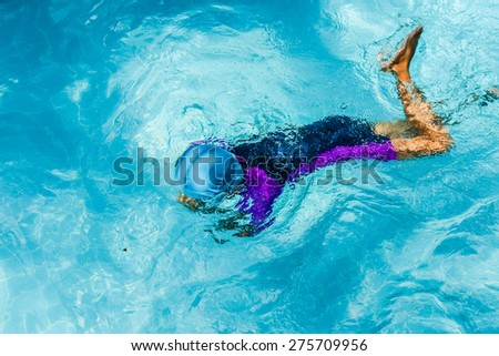 children having fun in  the swimming pool - stock photo