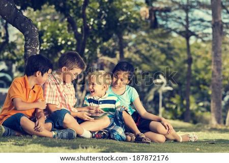 Children having fun using digital tablet - stock photo
