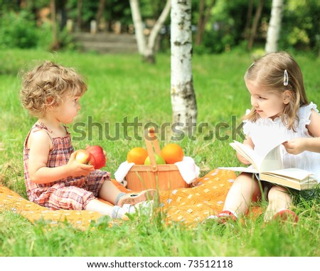 Children having picnic in summer park - stock photo