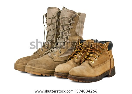 Children  hiking boots and adults army boots isolated on white background