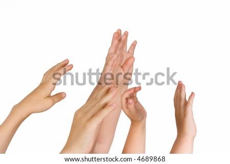 Children hold hands upwards on a white background - stock photo