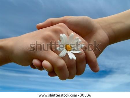 Children holding hands, symbolizing friendship. - stock photo