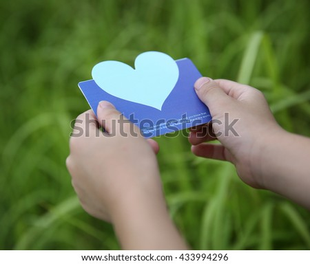 Children holding or showing card  - stock photo