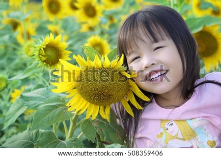 Children in a field of beautiful sunflowers.Mother and child love Asians. Family photo. Family photo for the background. Happy family.