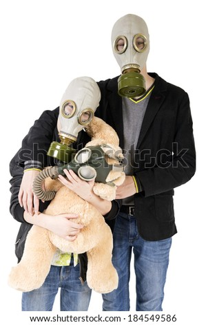 Children in a gas mask with a toy. Anti-war concept - stock photo