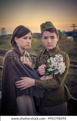 children in a military uniform. Historical reconstruction of the Great Patriotic War. Soviet troops. Girls see off soldiers on war