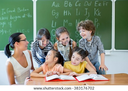 Children in class at school - stock photo