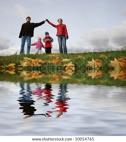 children in family house. autumn. river - stock photo