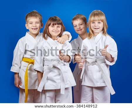 Children in karate gi are showing finger super - stock photo