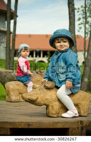 children in park on the attractions - stock photo