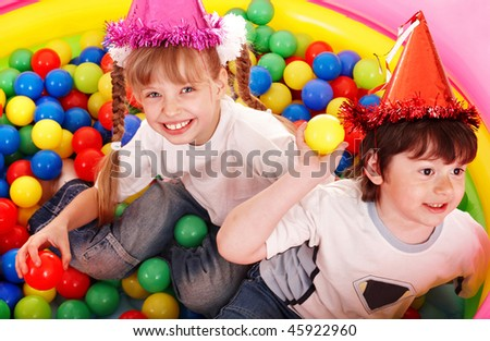Children in party hat with ball. - stock photo