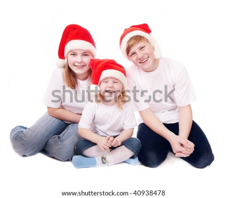 children in red christmas hats isolated on white