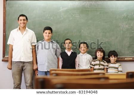 Children in school, from kindergarten, preschool, elementary age, to college boy - stock photo