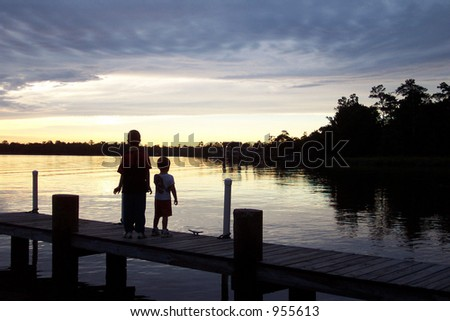Children in Silhouette on Pier
