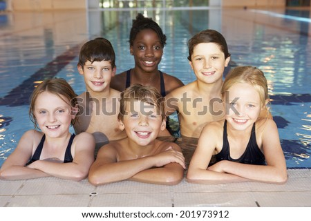 Children in swimming pool - stock photo