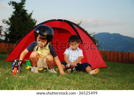 Children in tent, outdoor are playing