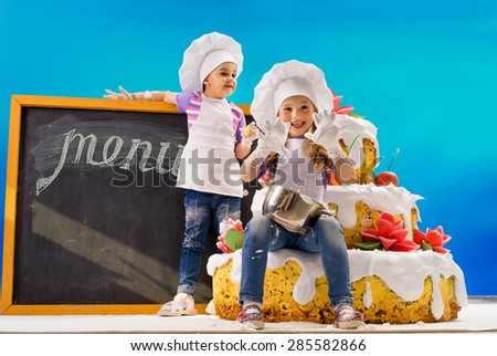 Children in the baked cake confectionery - stock photo