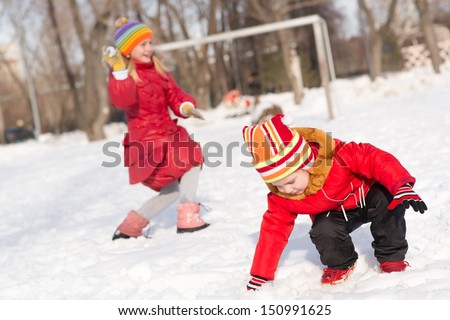 Children in Winter Park playing snowballs, actively spending time outdoors