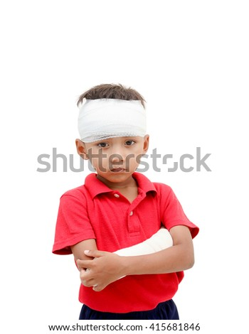Children injured has a grimace and showing his broken arm and bandaged at head.