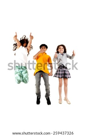Children jumping and thumbs up . - stock photo