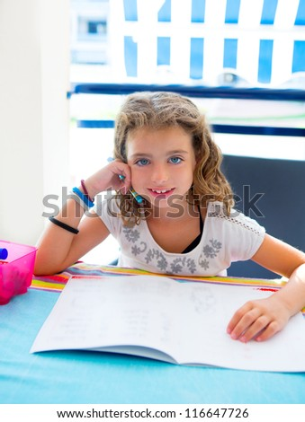 children kid girl smiling with homework in summer holding pencil - stock photo