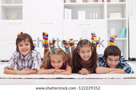 Children laying on the floor wearing colorful socks