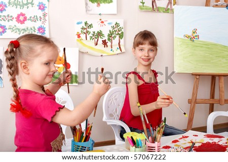 Children learn painting pencil in art class. - stock photo
