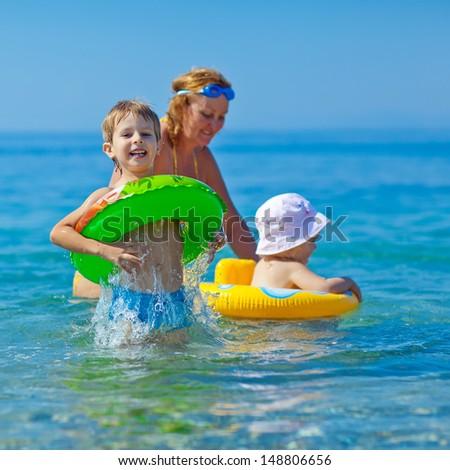 Children learn to swim in the sea - stock photo