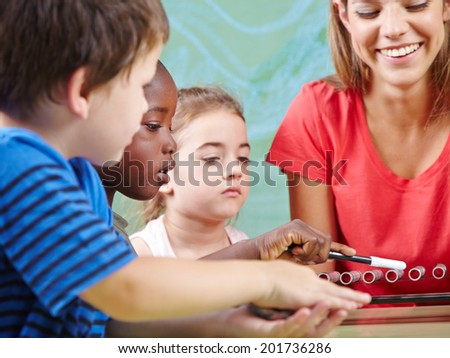 Children learning instruments in music school in musical education class - stock photo